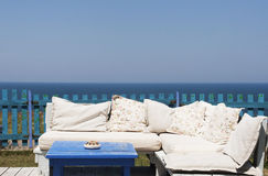 Summer dream concept. Sofa with pillows by the sea Stock Images