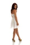 Summer Dress. A portrait of sexy brunette in summer white dress Royalty Free Stock Image