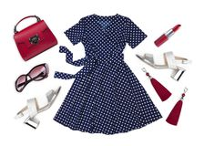 Summer dress and various female accessories isolated on white background royalty free stock image