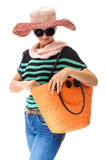 Summer dressed woman looking in bag Stock Image