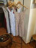 Summer dresses. On hangers on a rack stock photos