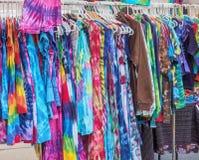 Summer dresses hanging on the street market Stock Image