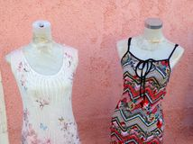 Summer  Dresses. Two female shaped shop mannequins wearing light summer dresses Royalty Free Stock Photos