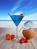 Summer drink. Summer martini drink with blur beach on background Royalty Free Stock Photo