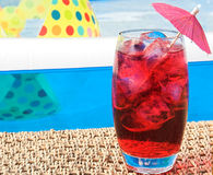 Summer drink. Fruit drink with ice by the pool stock images