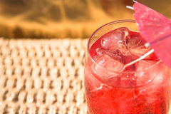 Summer drink. Fruit drink with ice by the pool stock image
