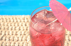 Summer drink. Fruit drink with ice by the pool royalty free stock image