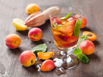 Summer drink. With apricot ( or peach)  in glass, selective focus Stock Photo