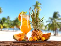 Summer drink with blur beach on background Royalty Free Stock Photography