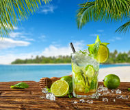 Summer drink with blur beach on background Stock Photos