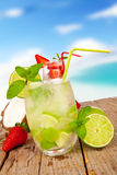 Summer drink. Fresh summer drink on wooden table with blur sea background Stock Image