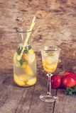 summer drink with lemon and peach stock photo