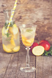 Summer drink with lemon and peach. Fresh lemonade  with lemon and peach, summer drink, sangria, cocktail Stock Images