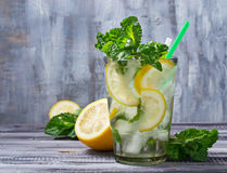 Summer drink mojito with mint, lemon and ice Royalty Free Stock Photos