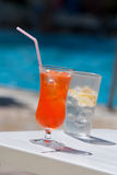 Summer drinks. Iced drinks placed on board a private pool royalty free stock image
