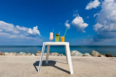 Summer drinks with blur beach on background. Summer drinks with sky and beach background Royalty Free Stock Photography