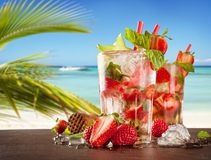 Summer drinks with blur beach on background Royalty Free Stock Images