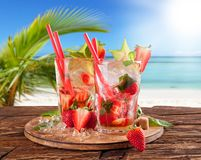 Summer drinks with blur beach on background Stock Image