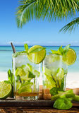 Summer drinks with blur beach on background Stock Photography