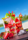 Summer drinks with blur beach on background Stock Photos