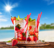 Summer drinks with blur beach on background Stock Images