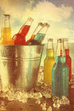 Summer drinks in ice bucket at the beach with vintage look. Cool summer drinks in ice bucket at the beach with vintage look stock photo