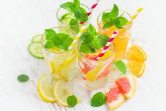 Summer drinks with ice, mint and citrus. Infused water in glass Royalty Free Stock Images