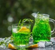 Summer drinks. Refreshing lemonade from lemons, mint and tarrago Stock Image
