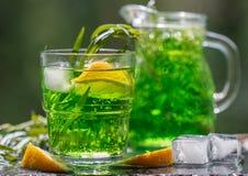 Summer drinks. Refreshing lemonade from lemons, mint and tarragon Stock Image
