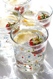 Summer drinks water lemon strawberry ice Royalty Free Stock Images