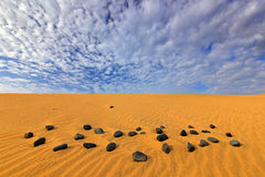 Summer dry landscape in Africa. Black pebble stone. Sand waves in the wild nature. Dunas Maspalomas, Gran Canaria, Spain. Yellow s Royalty Free Stock Photos