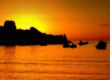 Summer Dusk. Typical Mediterranean sunset in a tranquil beach in Malta Royalty Free Stock Images