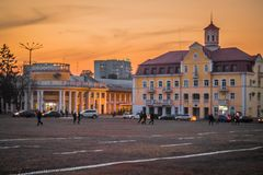 Summer or early autumn square of ukrainian town at sunset royalty free stock photo