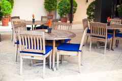 Summer empty open air cafe near swimming pool Royalty Free Stock Image