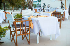 Summer empty open air luxury restaraunt at exotic hotel. Summer empty open air cafe near sea at exotic island stock photography