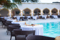 Summer empty open air luxury restaraunt at exotic hotel. Summer empty open air cafe near sea at exotic island royalty free stock image