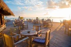 Summer empty open air restaraunt near sea at exotic island on beautiful sunset. Summer empty open air cafe near sea at exotic island stock image