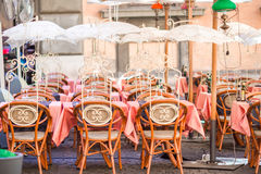Summer empty open air restaraunt in Pisa in Italy. Closeup wineglasses on the table Royalty Free Stock Images