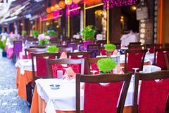 Summer empty open air restaraunt at tourist city.  royalty free stock photos