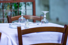 Summer empty open air restaraunt in Vatican city in Italy. Closeup wineglasses on the table Royalty Free Stock Image
