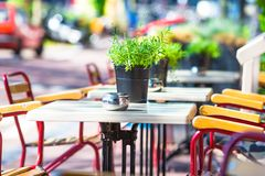 Summer empty outdoor cafe at tourist european city Royalty Free Stock Images