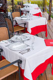 Summer empty outdoor restaraunt with white tablecloths. Summer empty outdoor cafe on shore at exotic island in indian ocean stock photo