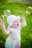Summer Enjoyment. Happy laughing little girl enjoying summer and soap bubbles Stock Images