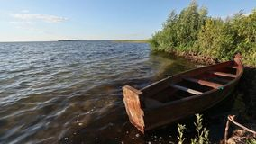 Summer Evening Lake View with wooden Boat. stock footage