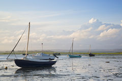 Summer evening landscape of leisure boats in harbor at low tide. Leisure boats at low tide in harbor during Summer sunset Stock Photos