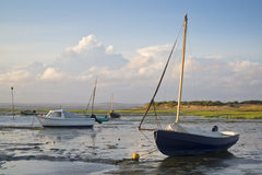 Summer evening landscape of leisure boats in harbor at low tide Stock Photo