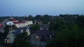 Summer evening in provincial town Volokolamsk, Moscow region. Video of the Central part of Volokolamsk, shot from the hill of the local ancient Kremlin stock footage