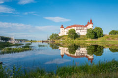 Summer evening in Sweden. Lidkoping, Sweden - July 23, 2016: Summer evening by Lake Vanern and Lacko Castle. Lacko castle dating back to the 13th century has royalty free stock image