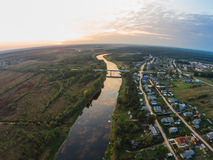 Summer evening in the village by the river Mologa. Sunset. Evening view from height of bird's flight on the river Mologa and the sunset Stock Photos
