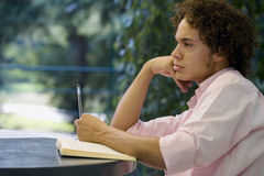 Summer exams. The guy is preparing his final exams royalty free stock images
